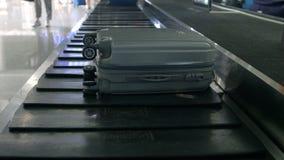 Airport baggage claim with luggage spinning around conveyor royalty free stock photos