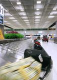 Airport baggage Hall. Bags arrive on a Baggage belt royalty free stock photos