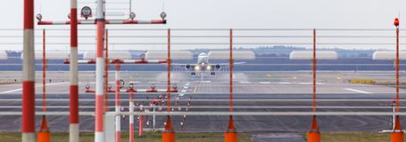 Airport beacons with starting airplane in the daylight. Some airport beacons with starting airplane in the daylight Royalty Free Stock Photos