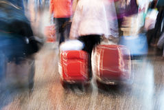 Airport blur. At the airport - tourist or worker running to the gate with trolley and baggage Royalty Free Stock Photo