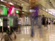 Airport blur. Motion blur image of people carrying luggages in a Japanese Airport Royalty Free Stock Photo