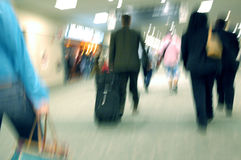 Airport Blurs 1. People In a rush at the airport with a motion blur Royalty Free Stock Photos