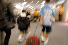Airport Blurs 3. Children (2 boys) and their mother rush through the airport Stock Photo