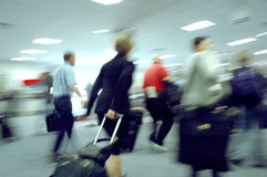 Airport blurs 4. A woman rushes through the crowd to her gate Stock Image
