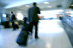 Airport Blurs 5. Business man and a pilot pass each other as they move towards opposite terminals Stock Photography