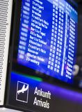 Airport board. Showing arrivals and departures on time Royalty Free Stock Photos