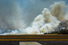 Airport Brush Fire in El Salvadore, Central America Royalty Free Stock Images