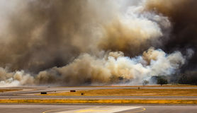 Airport Brush Fire in El Salvadore, Central America. Brush fire closes in on San Salvador International Airport runways and taxiways San Salvador, Central Stock Photos