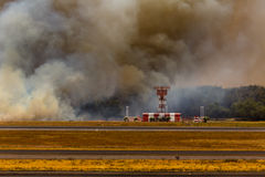 Airport Brush Fire in El Salvadore, Central America. SAN SALVADORE, EL SALVADOR - MARCH 3, 2013: Brush fire threatens radar at San Salvador International Airport Stock Photos