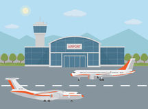 Airport building and airplanes on runway. Stock Photo