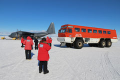 Airport bus in Antarctica. Scientists about to leave McMurdo station on a New Zealand Air Force C130 Hercules transport aircraft. Aircraft use a blue ice runway Stock Images