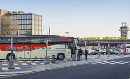 Airport bus at Milan, Italy`s Terminal 2 departure terminal, hub of budget airliner, Easyjet, servicing short-haul. Milan Malpensa, Italy - November 21st, 2017 Royalty Free Stock Photos