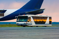 Airport bus in the morning light. Airport bus shuttle in the morning light royalty free stock photos