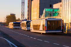 Airport buses in the morning light. Near the terminal under construction stock photography