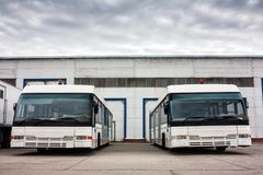 Airport buses in the parking lot. Near the garages Royalty Free Stock Photography