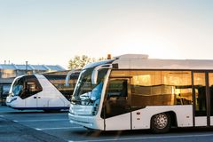 Shuttle buses at the parking lot of the airport. Airport buses at the parking lot royalty free stock image