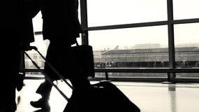Airport Business Passenger Silhouette. Black and white Royalty Free Stock Photo