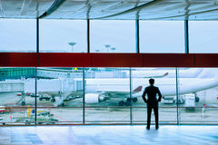 Airport. Businessman standing in the international airport royalty free stock photos