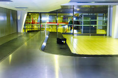 Airport carousel with a suitcase Royalty Free Stock Photos