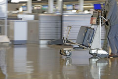 Airport cart. Motion image of a man pushing a cart in an airport Royalty Free Stock Photo