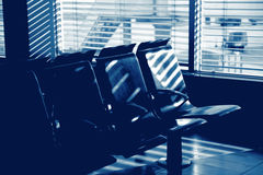 Airport chairs in a row - blue tone Stock Photography