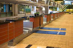 Airport Check in Counter. Row of airport check-in counter with two blue carpet for business and executive class passenger Royalty Free Stock Photos