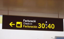 Airport check in desk sign. Check in sign at a spanish airport Royalty Free Stock Photos