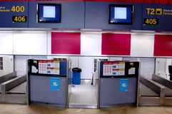Airport check in desks. Unattended check-in desks inside an airport Royalty Free Stock Images