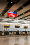 Airport Check in Desks and Customs Sign. Closed check in desks and Customs sign at Heathrow airport Royalty Free Stock Images