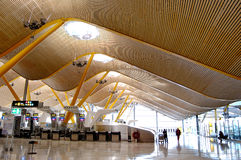 Airport check-in hall. Large empty airport check-in hall with modern wooden wave ceiling Stock Images