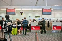Airport check-in process. Virgin Atlantic airport check-in control Royalty Free Stock Photo