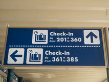 Airport Check-in Sign. With direction in Italian airport Stock Photos