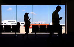 Airport Commuters. Passengers moving between departure lounges in Airport Stock Image