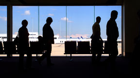 Airport Commuters. Passengers moving between departure lounges in Airport Stock Photography