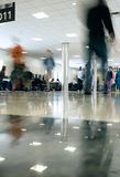 Airport Concourse People Rushing. Long exposure motion blur at extremely low angle of people rushing along the airport concourse royalty free stock photography