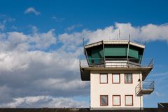 Airport control tower. Top of Airport control tower , with blue sky and white clouds in the background Stock Photo