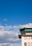 Airport control tower. Against blue sky and white clouds Royalty Free Stock Photo