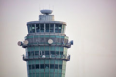 Airport Control Tower. Hong Kong International Airport control tower. Image shows detail of the building, microwave transmitters and receivers as well as radio Stock Photo