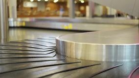 Airport conveyor belt for luggage. Close up of an empty airport conveyor belt for luggage. Concept of tourism and travel. Locked down real time close up shot stock footage