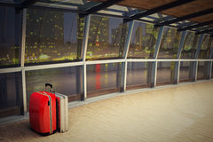 Airport corridor with a luggage stack at night Stock Photo