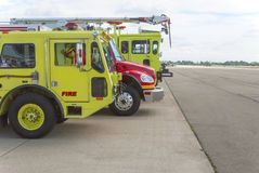 Airport Crash Tenders. Three fire engines lined up on an airport tarmac Royalty Free Stock Image
