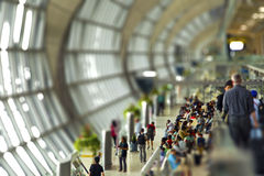 People queing at a busy crowded airport Stock Photos