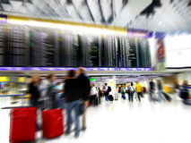 Airport Crowd Motion Blur. Passengers walking around in a airport departure terminal -Motion Blur Stock Photography