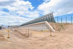 Airport deflector barrier under construction. stock photos