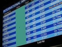 Airport Departure Board. A flat-panel television listing the departure and arrival times at an international airport Stock Photo