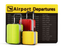 Airport departure board and suitcases Stock Photo