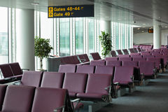 Airport departure gate. Airport terminal departure lounge with gate sign and seating Royalty Free Stock Image