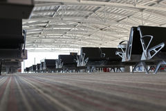 At the airport. Airport departure lounge. Empty rows of seats Royalty Free Stock Images