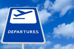 Airport Departure Sign. Blue and White Airport Departure Sign against a Cloudy Blue Sky Royalty Free Stock Images