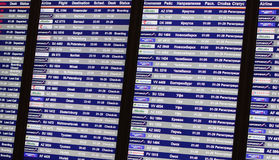 Airport departures and arrivals information board Stock Photos